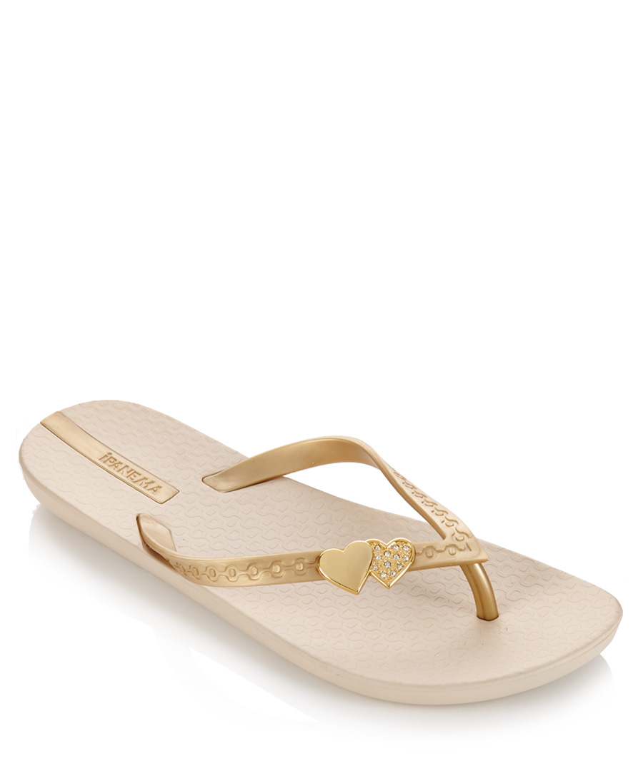Women's Sandals Our Women's sandals enhance classic flip flops, slides, wedges, and slip-ons with premium UGG materials and state-of-the-art innovations. Our newest Imprint Collection consists of strappy sandals, slides, flip flops, and wedges with our soft Imprint by UGG™ insole.